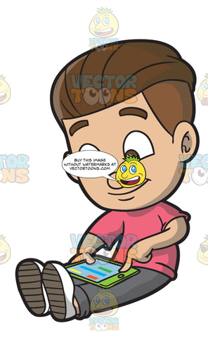 A Boy Indulgently Plays An App On His Mobile Tablet