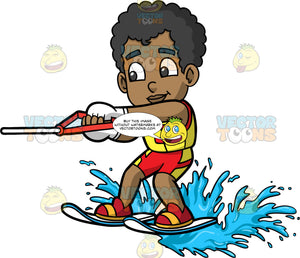 Young Jimmy Having Fun Water Skiing. A young black boy wearing blue and yellow swim trunks, and a yellow life jacket, holding onto a handle as he is pulled behind a boat on water skis