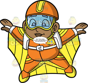 Young James Wingsuit Flying. A young black boy wearing an orange with yellow helmet, goggles, and an orange and yellow wingsuit, spreading his arms and legs out to fly through the air in his wingsuit