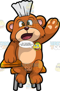 Brushy Bear Asking A Question At School. A cute brown bear with brown eyes and a white bristle mohawk hair cut, sitting at his school desk and raising his paw to ask a question