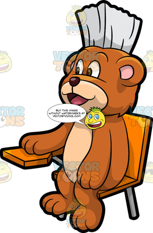 Brushy Bear Sitting At A School Desk. A cute brown bear with brown eyes and a white bristle mohawk hair cut, sitting in a desk and learning while at school