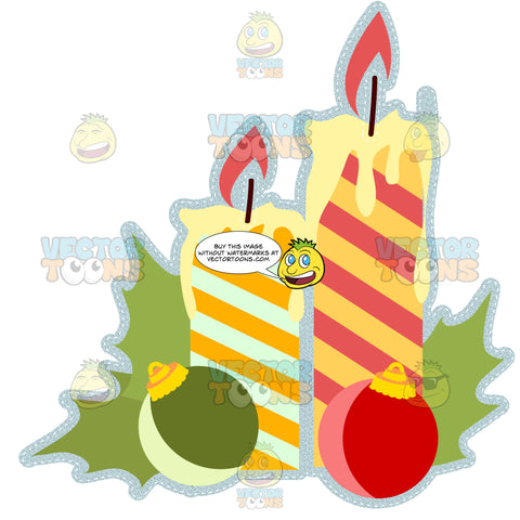 Two Yellow Striped Lit Holiday Christmas Candles With Ball Ornaments And Holly Leaves