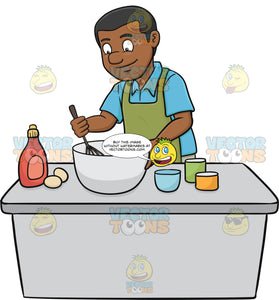 A Black Man Enjoys Mixing The Cake Batter