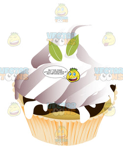 Chocolate And Vanilla Marble Cupcake With White Icing And Mint Leaf Decorations