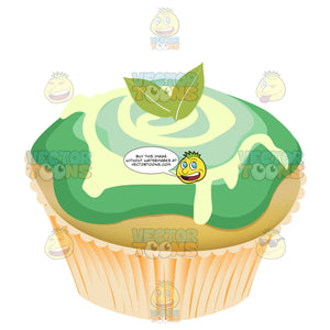 Mint Green Swirled Icing Decorated Cupcake With Mint Leaves On Top