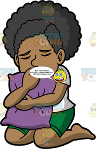 Jackie Hugging A Pillow In Sadness. A black woman wearing green shorts and a white t-shirt, kneeling on the floor hugging a purple pillow with her eyes closed in sadness