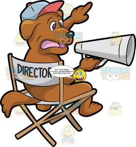 A Dog Director. A dog with brown coat, wearing a light blue with light red cap, sitting on a gray folding chair with wooden frame and the word director printed at the back, as it directs instruction using a gray megaphone in its left hand