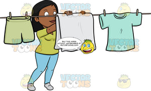 A Cheerful Black Woman Hanging Garments To Dry On A Bright Day