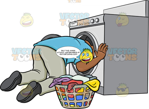 A Black Man Searching For A Missing Object Inside The Washing Machine