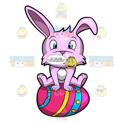 A Cute Easter Bunny Sitting On A Pretty Egg