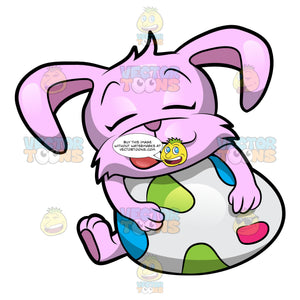 A Cute And Adorable Easter Bunny Resting And Hugging A Big Easter Egg