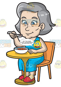 A Mature Woman Sipping Some Soup