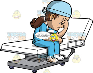 A Tired Healthcare Worker Sitting On A Hospital Bed. A woman wearing blue scrubs, white shoes, a blue cap and a face mask around her neck, sitting on a hospital bed with one hand covering her eyes and the other resting on her leg