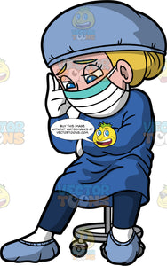 A Fatigued Surgeon Taking A Break. A female surgeon wearing a blue gown over blue scrubs, blue booties, a blue cap, white gloves and a surgical mask, sitting on a stool resting her head on one hand and looking drained