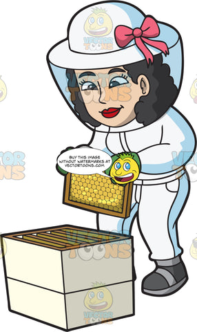 A Female Beekeeper Arranging A Honeycomb Frame In A Hive Box