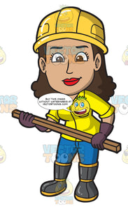 A Female Construction Worker Holding A Piece Of Wood