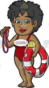 A Female Lifeguard Holding A Whistle And Life Ring. A black female lifeguard, wearing a red one piece bathing suit, standing on the beach holding a red whistle in one hand, and a red and white life ring in the other