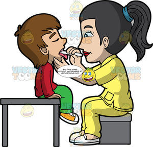 A Female Pediatrician Checking The Tonsils Of A Young Boy. A female pediatrician with black hair in a ponytail, wearing a yellow scrub suit, white shoes, sitting on a gray stool as she checks the tongue of a young boy with brown hair, wearing a red sweatshirt, green pants, yellow orange with white shoes, who is sitting on top of a gray table