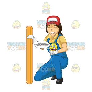 Woman Plumber Kneeling Next To A Pipe And Smiling