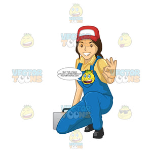 Female Plumber Giving The A-Ok Sign While Kneeling