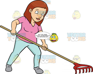 A Woman Using A Garden Rake