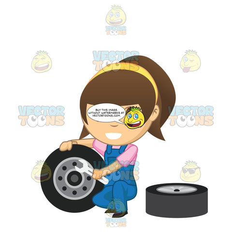 Brunette Mechanic Holding A Wrench Up To A Tire