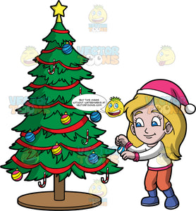 Young Stacey Putting Decorations On A Christmas Tree. A girl wearing orange pants, blue boots, a white with pink shirt, and a pink and white hat, putting ornaments on a Christmas tree