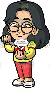 Young Lynn Eating Cookies And Cream Ice Cream. An Asian girl wearing red pants, a long sleeve yellow shirt, white shoes, and round eyeglasses, about to dig into her cup of cookies and cream ice cream