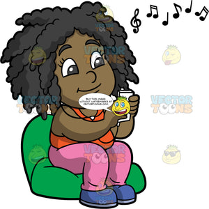 Lisa Sitting Down And Listening To Music. A black girl wearing pink pants, an orange tank top, and blue shoes, sitting on a green bean bag chair listening to music through headphones connected to her cell phone