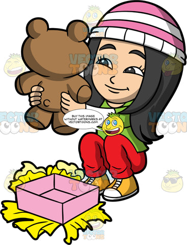 Young Connie Looking At A Christmas Gift. An Asian girl wearing red pants, a green and white shirt, yellow shoes, and a pink and white striped hat, sitting on the floor and admiring the teddy bear she just received