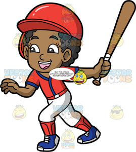 Young Jackie Running After Hitting A Ball. A young black girl wearing a baseball uniform, cleats, and a protective helmet, holding onto a baseball bat after just hitting the ball