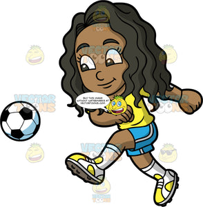 Young Maggie Kicking A Soccer Ball. A young black girl with long, curly hair, wearing blue shorts, a yellow shirt, white socks, and white and yellow soccer cleats, smiles after kicking a soccer ball