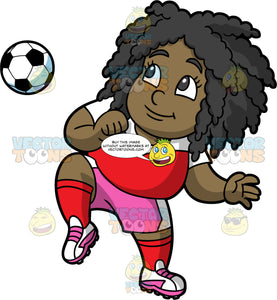 Young Lisa Having A Good Time Playing Soccer. A young black girl wearing pink shorts, a red with white shirt, red socks, and pink and white soccer cleats, lifting her knee up to try and bounce a soccer ball off it