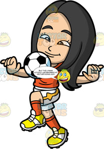 Young Connie Playing Soccer. A young Asian girl wearing white shorts, an orange shirt, orange socks, and yellow soccer cleats, lifting her one knee up to bounce a ball off it