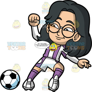 Young Lynn Playing Soccer. A young Asian girl wearing white with purple shorts, a purple and white striped shirt, purple socks, white soccer cleats, and round eyeglasses, using the side of her foot to stop a soccer ball