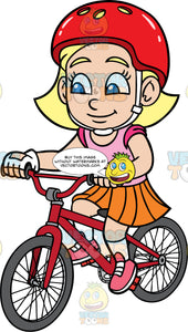 Young Mary Riding Around On Her Red Bike. A young blonde girl wearing a red helmet, an orange skirt, pink shirt, and pink shoes, having fun riding her red bike