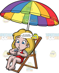 Young Stacey Sitting In A Beach Chair On A Summer Day. A girl with dark blonde hair, wearing a red bathing suit, sipping a drink through a straw while sitting in red and white striped beach chair under a rainbow coloured umbrella