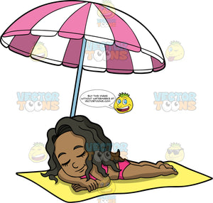 Young Maggy Relaxing In The Sun. A black girl wearing a pink bikini, lying on her stomach on a yellow beach towel with her eyes closed under a pink and white striped umbrella