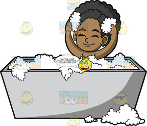 Young Jackie Enjoying A Hot Bubble Bath. A black girl sitting in a gray bathtub filled with bubbles, closing her eyes and smiling as she rubs bubbles into her hair
