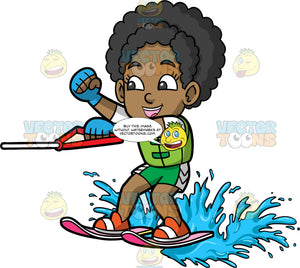 Young Jackie Having Fun Water Skiing. A cute black girl wearing green swim shorts and a green life jacket, having a great time as she skims along the water's surface on water skis