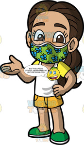 Young Isabella Wearing A Cute Face Mask. A Hispanic girl wearing yellow shorts, a white and yellow t-shirt, green shoes, and a green face mask with blue butterflies on it, standing with one hand on her hip and the other out to the side