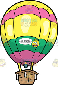 A Colorful Hot Air Balloon. A hot air balloon with a brown basket, green burner, yellow with pink and green round balloon