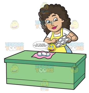 A Woman Removing The Hardened Soaps From The Molds