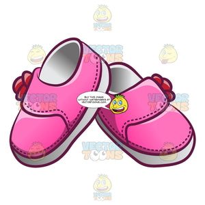 A Cute Tiny Pair Of Baby Shoes For Girls