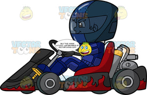A Young Boy Racing A Go-Kart. A boy wearing a full face blue helmet, blue racing suit and boots, concentrates as he races his red and black go-kart