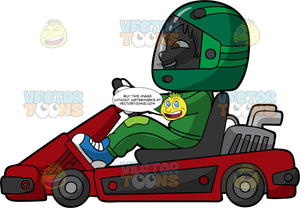 A Boy Racing A Red Go-Kart. A boy wearing a green full face helmet, green racing suit, white gloves and blue shoes, smiles as he races around the track on his red go-kart