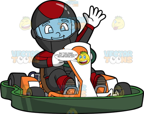 A Boy Waves As He Crosses The Finish Line In His Go-Kart. A happy boy wearing black and red racing gear and helmet, waves one hand while the other hand holds the steering wheel of the orange and white go-kart he is driving
