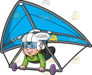A Boy Flying A Blue Hang Glider. A boy wearing a white helmet, goggles and a green shirt, strapped into a blue hang glider, hangs on as he glides through the air