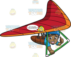 An Excited Black Boy Having Fun Hang Gliding. A happy black boy wearing a blue helmet and shirt, gives the thumbs up with one hand while the other hand holds onto the bar of the hang glider that he is strapped into