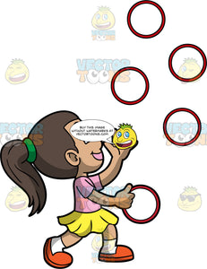 A Happy Girl Juggling Rings. A girl with brown hair tied up in a ponytail, wearing a yellow skirt, a pink shirt, white socks, and orange shoes, smiles as she juggles five red rings